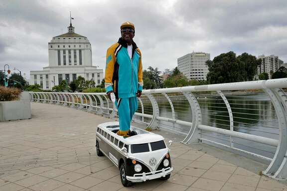 Darren Powell poses for a portrait on his Free•Double•You Bus motorized skateboard, which he custom built in his live/work space in Oakland, Calif., on Thursday, August 8, 2019. Powell runs Freejac Nation, a company he founded for customizing skateboards that are both manually-powered and motorized. The more glamorous boards are eye-catching and he hopes to attract the attention of artists and rappers and begin to market the unique creations.