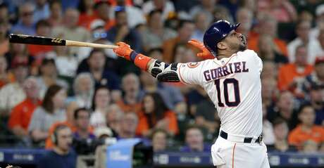Houston Astros first baseman Yuli Gurriel (10) watches his RBI hit during a baseball game against the Colorado Rockies Wednesday, August 7, 2019, in Houston. (AP Photo/Michael Wyke)