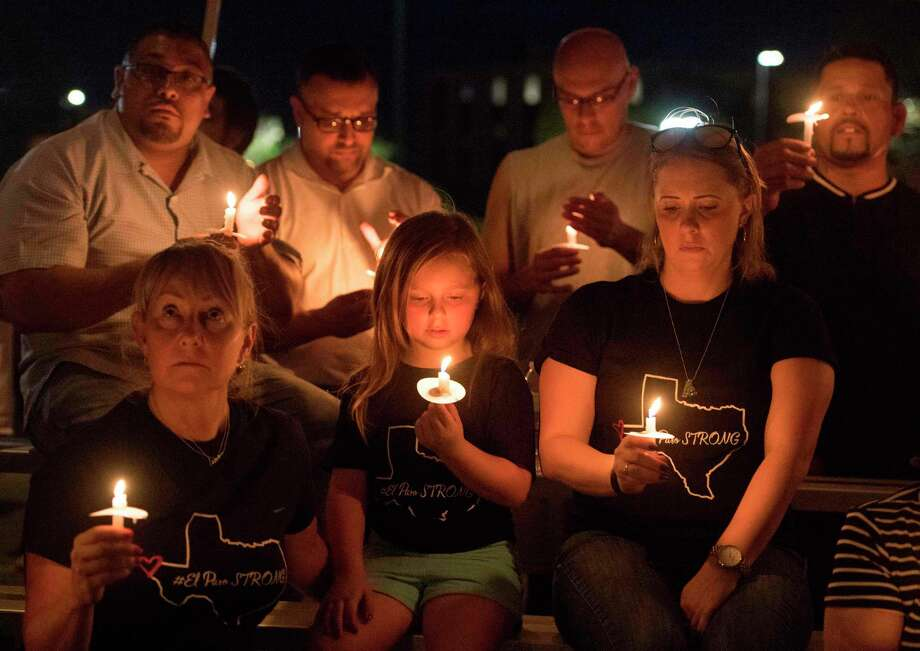 TOPSHOT - People pray during a candlelight vigil at the Immanuel Church for victims of a shooting that left a total of 22 people dead at the Cielo Vista Mall WalMart in El Paso, Texas, on August 5, 2019. - US President Donald Trump on Monday told a nation mourning 31 people killed in two mass shootings that he rejected racism and white supremacist ideology, moving to blunt criticism that his divisive rhetoric fuels violence. Trump will visit El Paso, Texas, on Wednesday following a mass shooting in the southern border town that killed 22 people, the local mayor said. (Photo by Mark RALSTON / AFP)MARK RALSTON/AFP/Getty Images Photo: MARK RALSTON / AFP or licensors