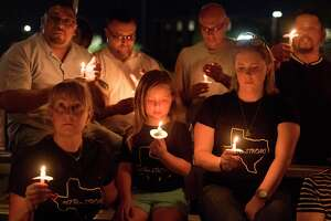 TOPSHOT - People pray during a candlelight vigil at the Immanuel Church for victims of a shooting that left a total of 22 people dead at the Cielo Vista Mall WalMart in El Paso, Texas, on August 5, 2019. - US President Donald Trump on Monday told a nation mourning 31 people killed in two mass shootings that he rejected racism and white supremacist ideology, moving to blunt criticism that his divisive rhetoric fuels violence. Trump will visit El Paso, Texas, on Wednesday following a mass shooting in the southern border town that killed 22 people, the local mayor said. (Photo by Mark RALSTON / AFP)MARK RALSTON/AFP/Getty Images