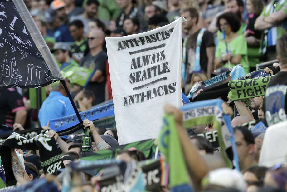 """A sign that reads """"Anti-Facist Always Seattle Anti-Racist"""" at a Seattle Sounders game last month. MLS' new policy bans political displays at matches. Photo: Ted S. Warren / Associated Press"""