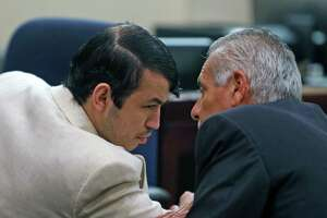 After being found guilty of murder Friday, Miguel Martinez confers with attorney Joel Perez. On Monday, the jury sentenced him to life in the killing UTSA graduate student Laura Carter.