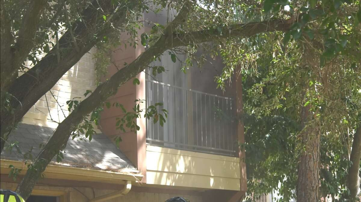 Houston firefighters work an apartment fire where a man was rushed to the hospital in southwest Houston on Friday, Aug. 9, 2019.