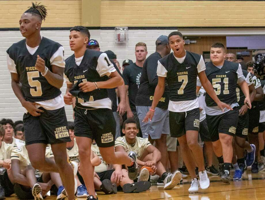The Conroe Tigers varsity football team runs into The Pit during the Meet the Tigers event Friday, August 9, 2019 at Conroe High School. Photo: Cody Bahn, Houston Chronicle / Staff Photographer / © 2019 Houston Chronicle