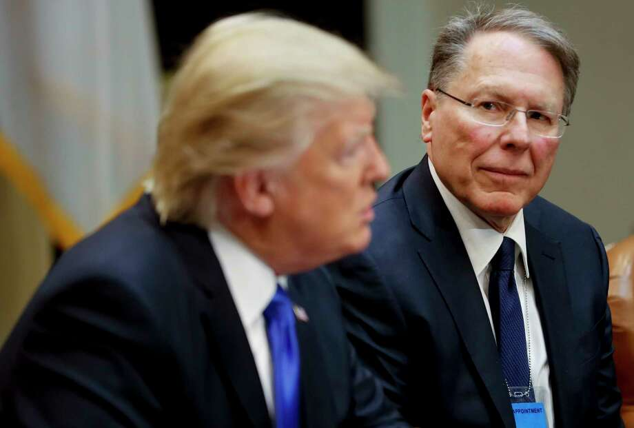 FILE - In a Feb. 1, 2017, file photo, National Rifle Associations (NRA) Executive Vice President and Chief Executive Officer Wayne LaPierre listens at right as President Donald Trump speaks in the Roosevelt Room of the White House in Washington. In the latest national furor over mass killings, the tremendous political power of the NRA is likely to stymie any major changes to gun laws. The man behind the organization is LaPierre, the public face of the Second Amendment with his bombastic defense of guns, freedom and country in the aftermath of every mass shooting. (AP Photo/Pablo Martinez Monsivais, File) Photo: Pablo Martinez Monsivais / Copyright 2017 The Associated Press. All rights reserved.