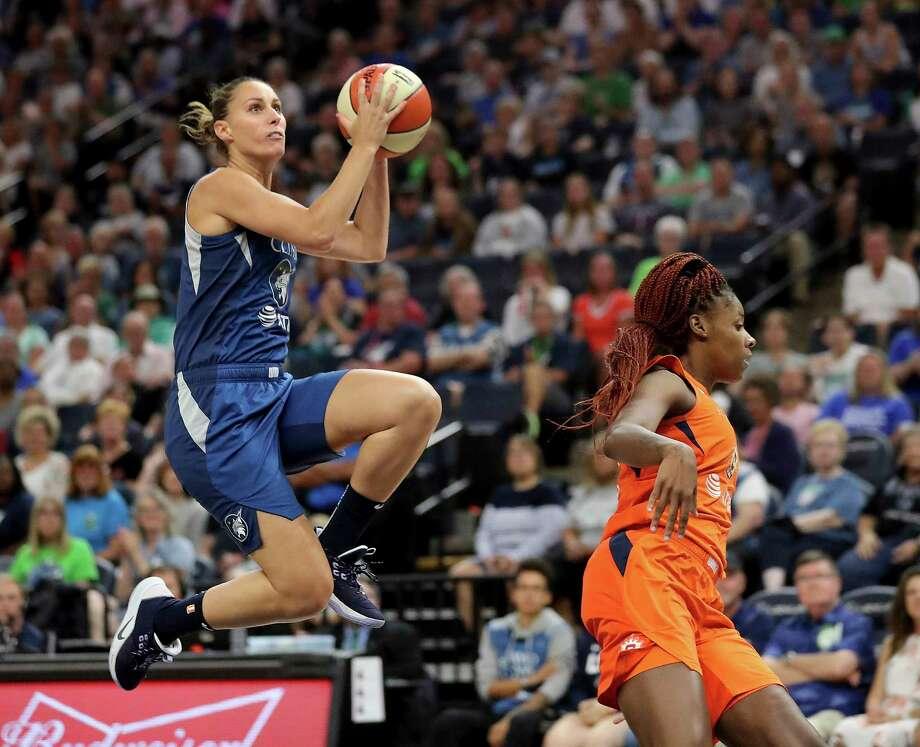 Minnesota Lynx's Stephanie Talbot, left, puts a move on Connecticut Sun's Bria Holmes (32) on her way to a fast break basket during the first quarter of a WNBA basketball game Friday, Aug. 9, 2019, in Minneapolis. (David Joles/Star Tribune via AP) Photo: David Joles / Star Tribune