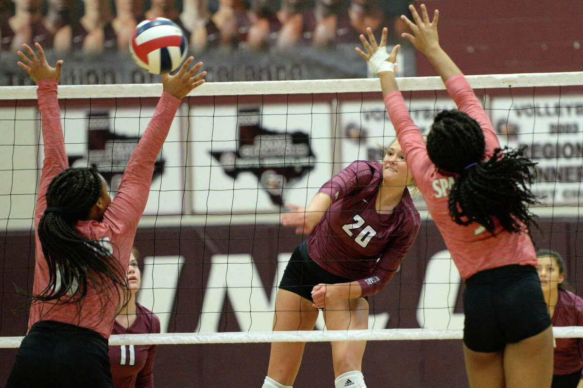 Madalyn O'Brien (20) of Cinco Ranch attempts a kill shot during the first set of a volleyball match between the Cinco Ranch Cougars and the Cy Lakes Spartans on Friday, August 9, 2019 at Cinco Ranch HS, Katy, TX.
