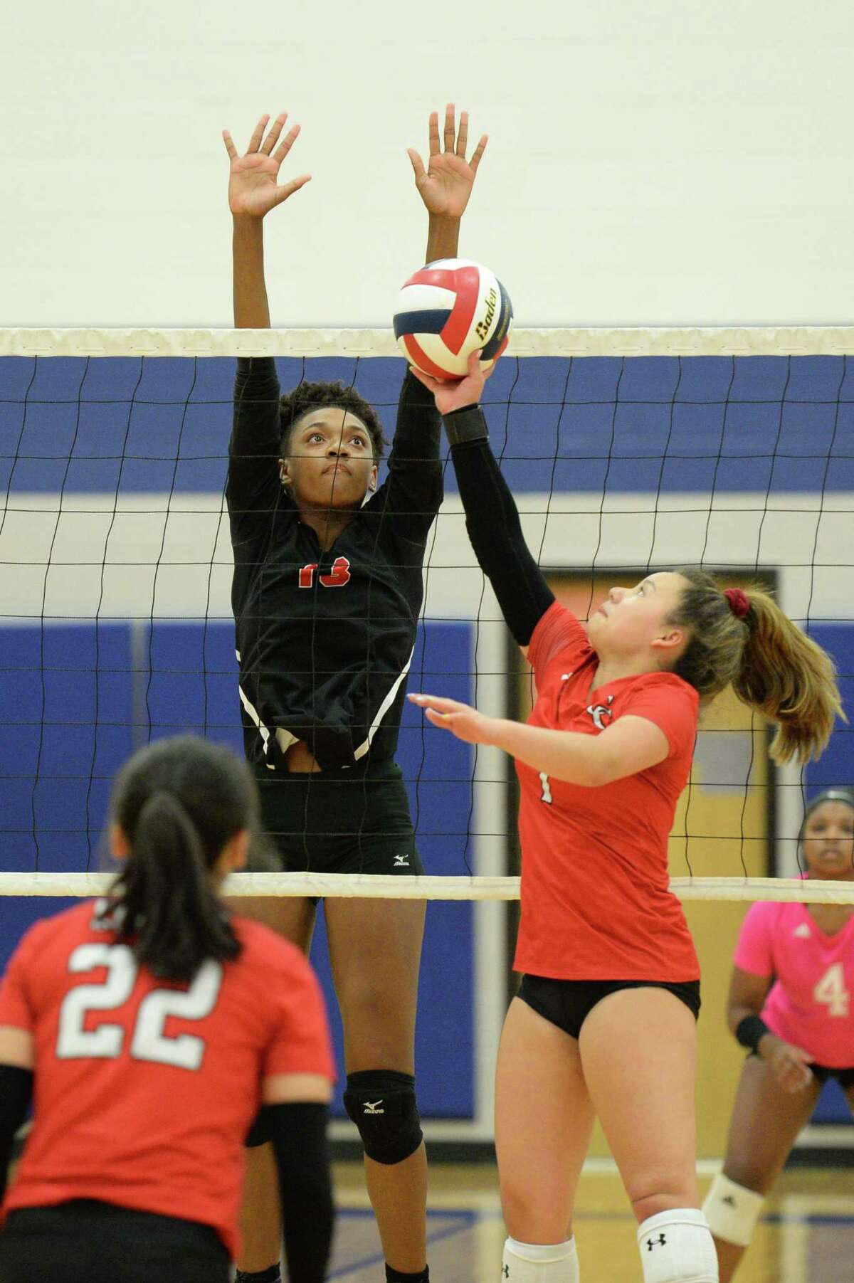 Gabrielle Johnson (13) of Austin attempts to block a shot earlier this season. The Bulldogs are returning to the playoffs.