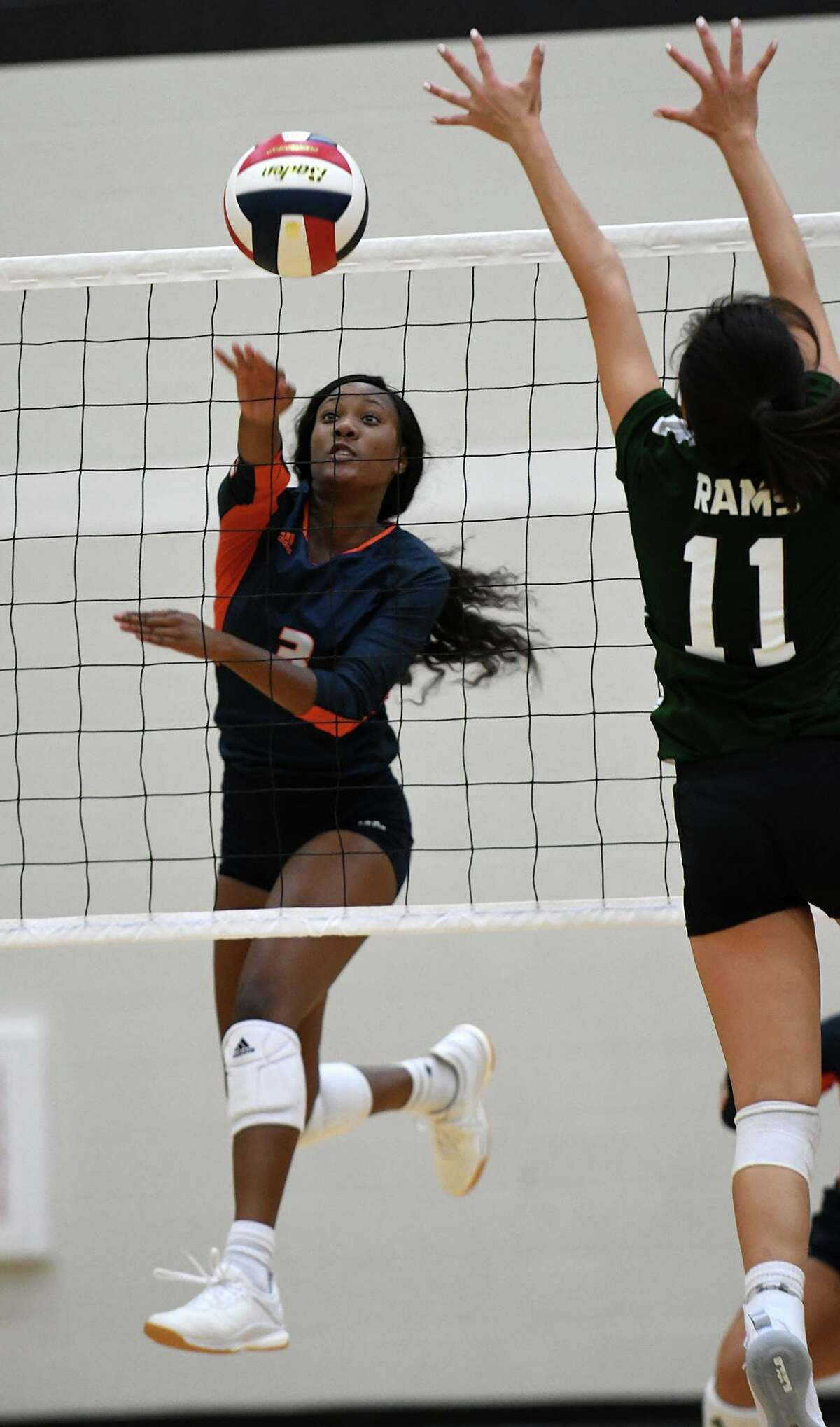 Bridgeland senior right side Alyssa McMorris (3) slams a ball past Cy Ridge sophomore outside hitter Christina Pham (11) during their pool play matchup in the 2019 Katy/Cy-Fair Volleyball Classic at Cy Parks High School on August 8, 2019.