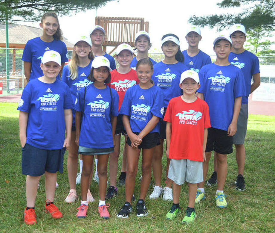 Some of the ball kids for the Edwardsville Futures pose for a photo before the start of first-round singles matches in the main draw on Wednesday morning at the Edwardsville High School Tennis Center. Photo: Scott Marion | For The Telegraph