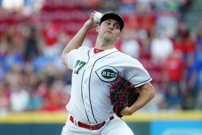 Cincinnati Reds starting pitcher Trevor Bauer throws in the first inning of a baseball game against the Chicago Cubs, Friday, Aug. 9, 2019, in Cincinnati. (AP Photo/John Minchillo)