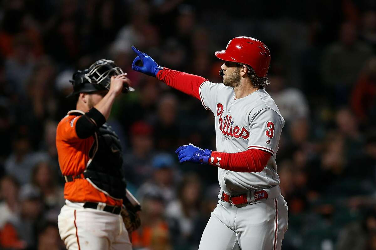 Bryce Harper #3 of the Philadelphia Phillies gestures to the fans after hitting a solo home run in the top of the fifth inning against the San Francisco Giants at Oracle Park on August 09, 2019 in San Francisco, California. (Photo by Lachlan Cunningham/Getty Images)