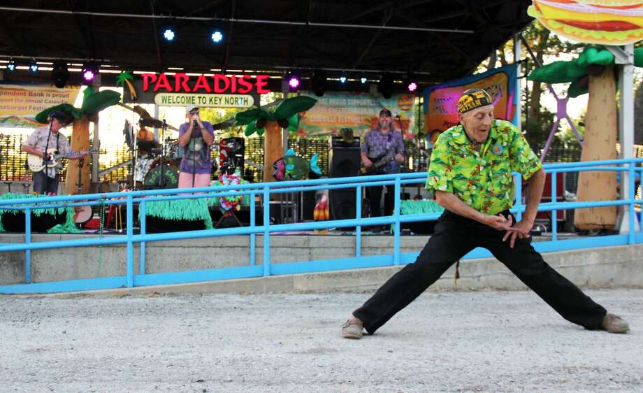 The annual Cheeseburger In Caseville Festival kicked off with the Kiwanis Best Cheeseburger Contest, and musical performances from Mike Shilakes and the Parrots of the Caribbean. The cheeseburger contest was won by Walt's Restaurant. Photo: Andrew Mullin/Huron Daily Tribune