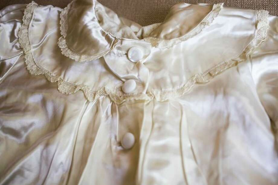 A christening coat which was made for Judy Main in 1948 from her mother's wedding dress has also been worn by Judy's brothers, children and grandchildren. (Katy Kildee/kkildee@mdn.net)