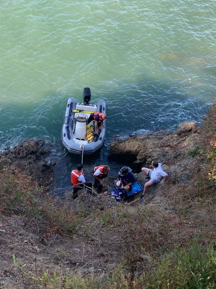 The San Francisco Fire Department rescued a father and son from a cliff at Aquatic Park Friday. The boy had gone off the cliff on a bicycle, prompting the rescue. Photo: San Francisco Fire Department