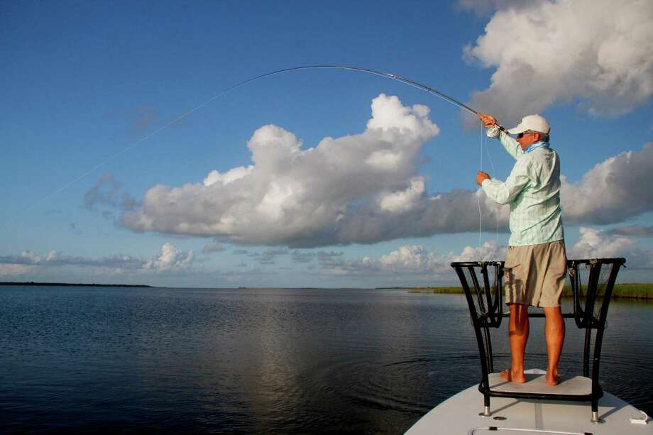 A summer morning spent in a skiff quietly poled on the expansive, shallow, sea grass-carpeted flats of Texas' middle coast offers anglers the experience of close-quarters encounters with redfish and other sport fish plus the opportunity to witness the vibrant, diverse and ever-surprising natural world of these dynamic estuaries. Photo: Shannon Tompkins / Houston Chronicle