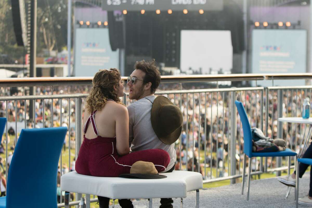 A couple hangs out at the The VIP Golden Gate Club near the the Lands End main stage at Outside Lands in Golden Gate Park in San Francisco, Calif. on August 9, 2019.