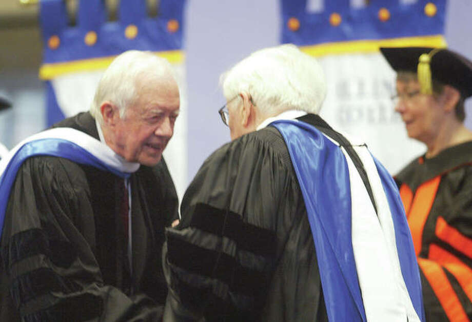 Former President Jimmy Carter greets longtime U.S. Rep. Paul Findley in 2014 after taking the stage at Illinois College. Carter spoke on a variety of issues, including the need to find peaceful solutions to world conflict. Photo: Journal-Courier