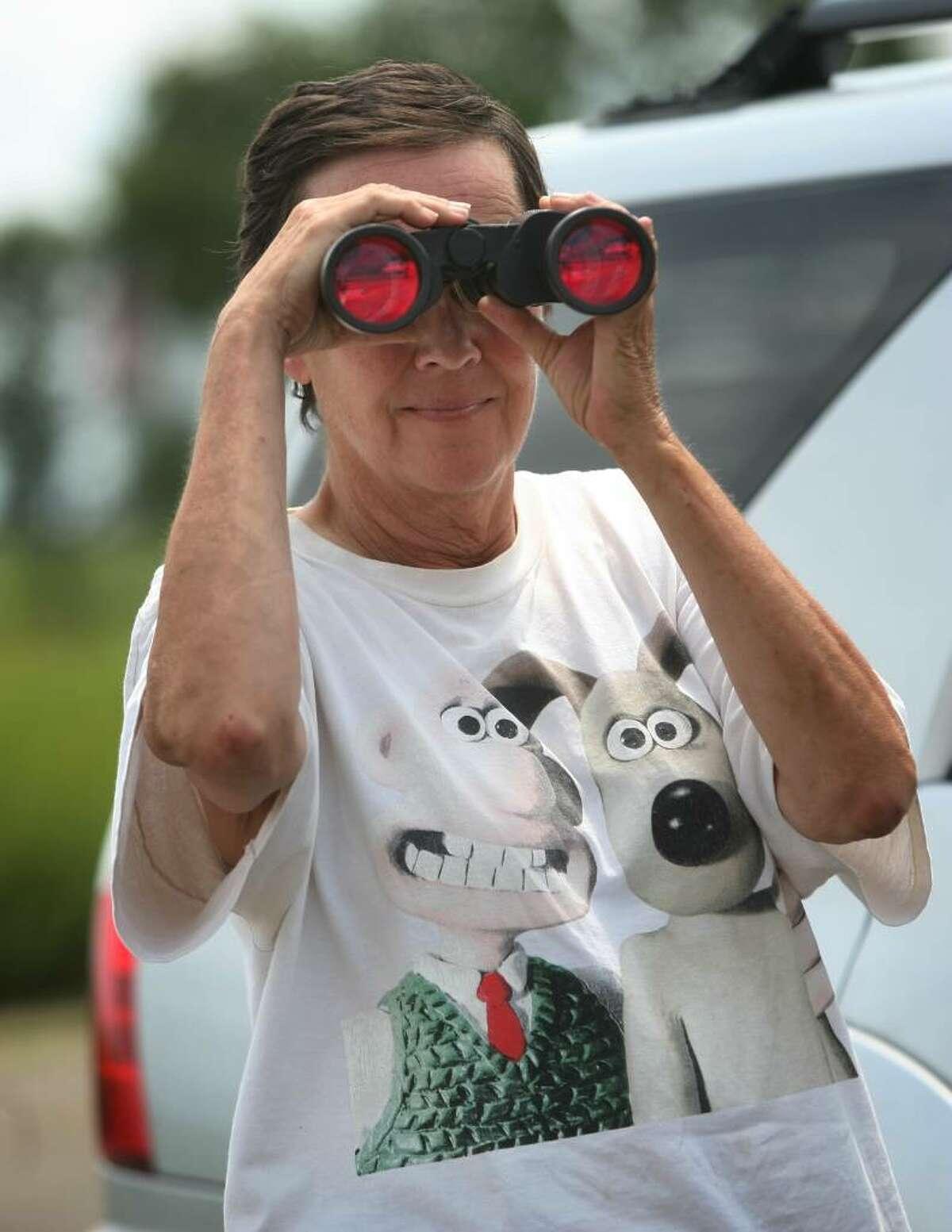 Birder Sam Saulys of Branford looks to spot the white-tailed kite on Stratford Point on Tuesday, August 3, 2010.