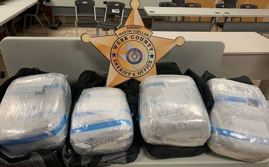 The Webb County Sheriff's Office said they seized these 48 pounds of marijuana while conducting an operation a local bus station in the 800 block of Flores Avenue. Two people were arrested in connection with the case. Photo: Courtesy Photo /Webb County Sheriff's Office