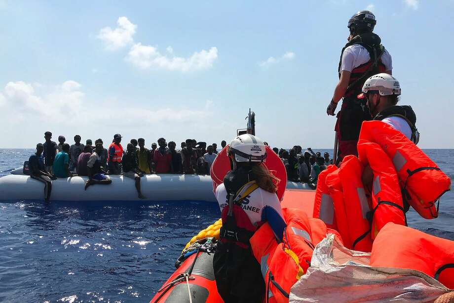 "Crew members of the 'Ocean Viking' rescue ship, operated by French NGOs SOS Mediterranee and Medecins sans Frontieres (MSF), stand ready on board of a ""rhib"", an inflatable dinghy, as they approach an inflatable boat carrying migrants on August 10, 2019, during their second rescue operation in the Mediterranean Sea. (Photo by Anne CHAON / AFP)ANNE CHAON/AFP/Getty Images Photo: Anne Chaon, AFP/Getty Images"