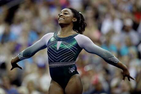 Simone Biles competes in the floor exercise during the senior women's competition at the U.S. Gymnastics Championships, Friday, Aug. 9, 2019, in Kansas City, Mo. (AP Photo/Charlie Riedel)