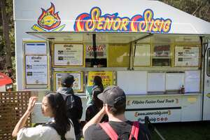 Customers line up at Senor Sisig  at the 2019 Outside Lands in Golden Gate Park in San Francisco, Calif. on August 9, 2019.