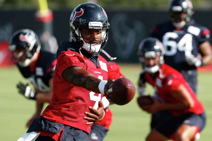 Houston Texans quarterback Deshaun Watson (4) runs a hand off drill during training camp at the Methodist Training Center on Aug. 10, 2019, in Houston.