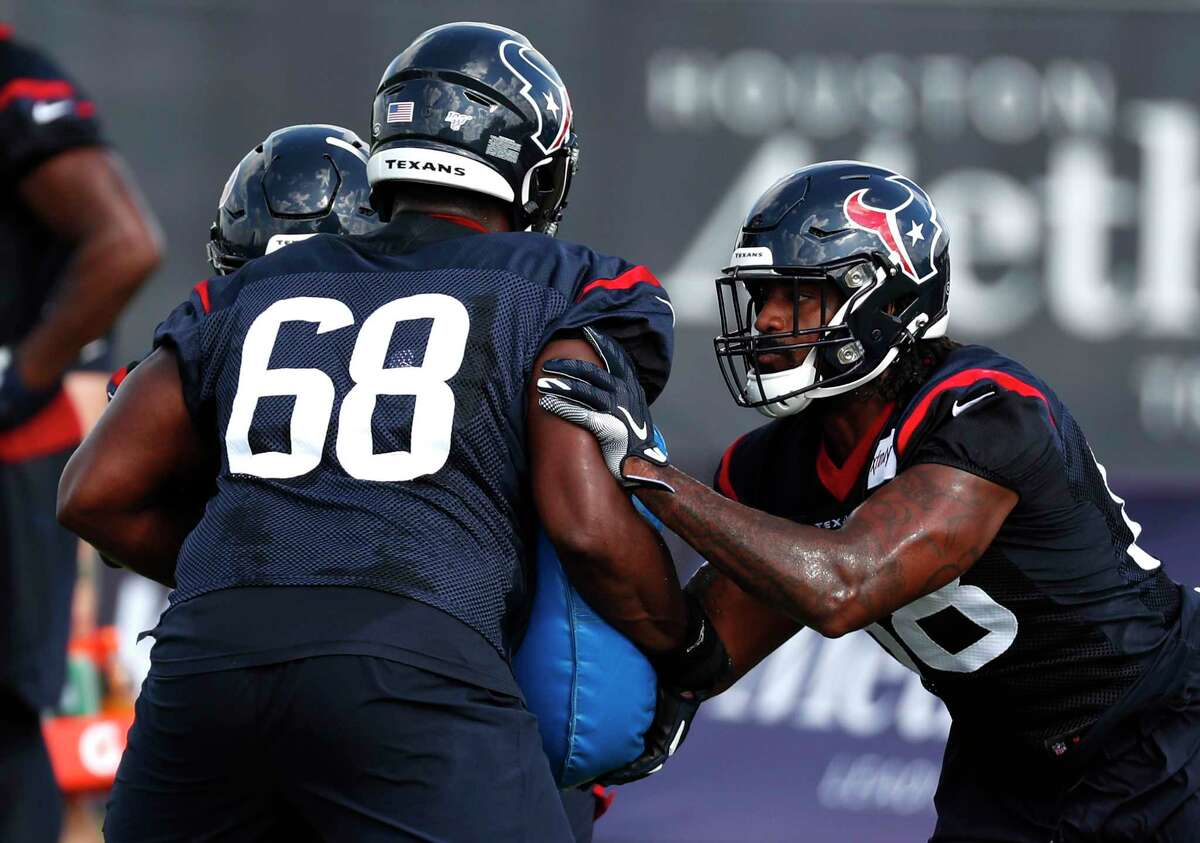 Houston Texans tight end Jordan Akins (88) hits a blocking pad held by guard Malcolm Pridgeon (68) during training camp at the Methodist Training Center on Aug. 10, 2019, in Houston.