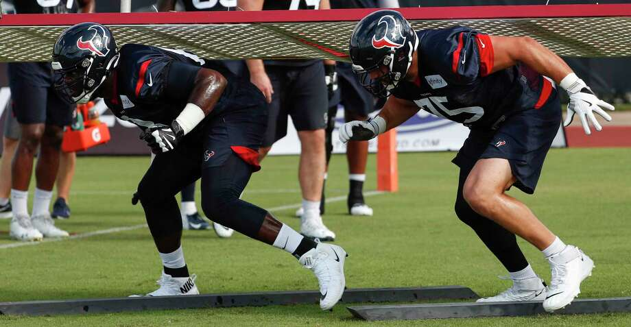 Houston Texans guard Malcolm Pridgeon (68) and tackle Matt Kalil (75) run a drill during training camp at the Methodist Training Center on Aug. 10, 2019, in Houston. Photo: Brett Coomer, Staff Photographer / © 2019 Houston Chronicle