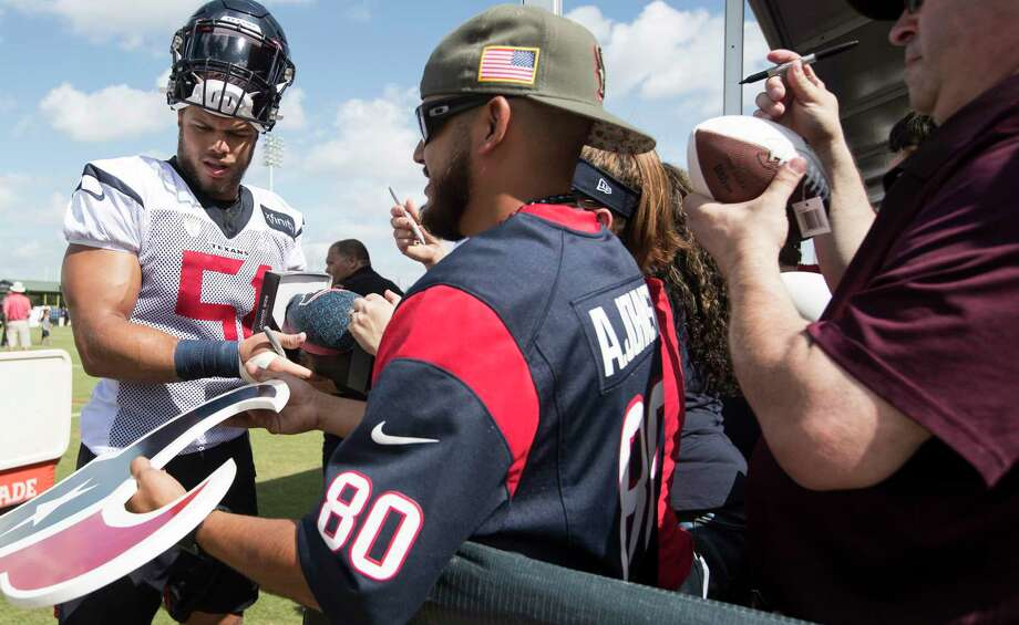 Houston Texans linebacker Dylan Cole (51) signs autographs during training camp at the Methodist Training Center on Aug. 10, 2019, in Houston. Photo: Brett Coomer, Staff Photographer / © 2019 Houston Chronicle