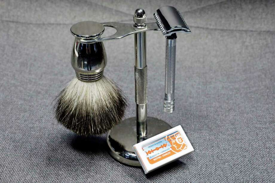 This photo, in New York, Tuesday, Aug. 6, 2019, shows a Col. Ichabod Conk shave set and Merkur double-edge razor blades.  Remember the old-school safety razor your grandfather used? Ita€™s making a comeback. Trendy direct-to-consumer brands have reintroduced them to younger generations. (AP Photo/Richard Drew) Photo: Richard Drew / Copyright 2019 The Associated Press. All rights reserved