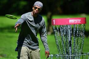 Ivan White competes in the disc golf tournament during The 3rd annual Cranbury Jam Saturday, August 10, 2019, at Cranbury Park in Norwalk, Connecticut. The jam included one round of disc golf doubles followed by a round of freestyle with trophies for the winners, as well as CTP prizes in disc golf. Freestyle routines were three minutes and played to random music.