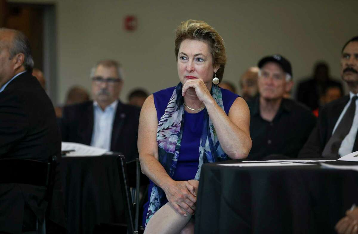 Harris County District Attorney Kim Ogg listens to bureau chiefs from the Harris County District Attorney's office speak about their roles during a community meeting on Saturday, Aug. 10, 2019, in Houston.