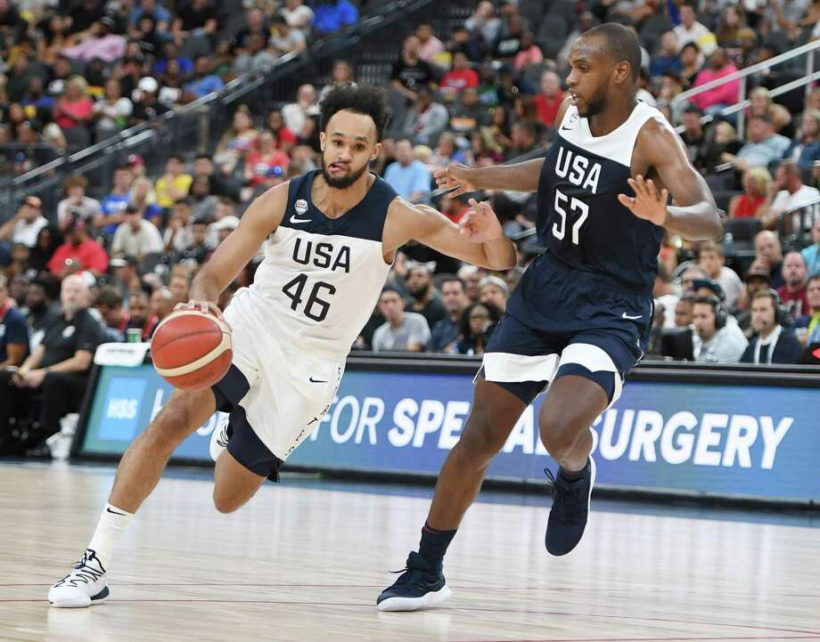 LAS VEGAS, NEVADA - AUGUST 09: Derrick White #46 of the 2019 USA Men's Select Team drives against Khris Middleton #57 of the 2019 USA Men's National Team during the 2019 USA Basketball Men's National Team Blue-White exhibition game at T-Mobile Arena on August 9, 2019 in Las Vegas, Nevada. (Photo by Ethan Miller/Getty Images) Photo: Ethan Miller, Staff / Getty Images / 2019 Getty Images