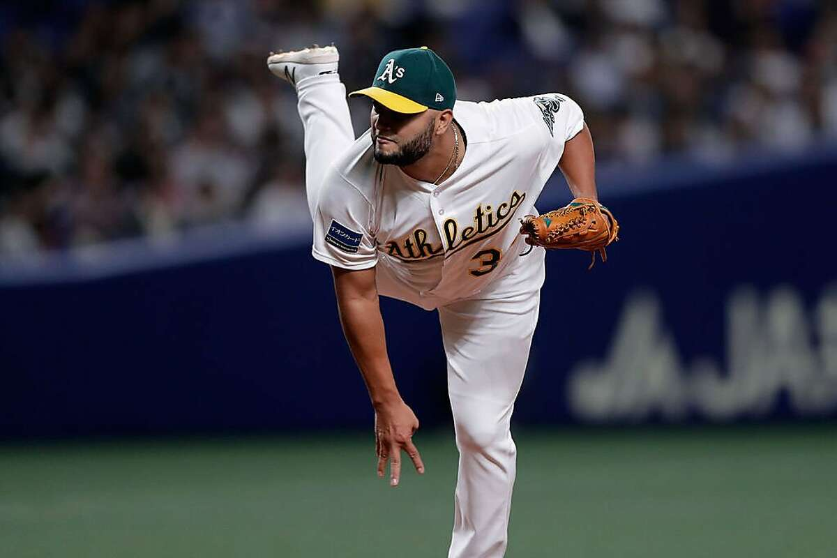 NAGOYA, JAPAN - NOVEMBER 15: Pitcher Yusmeiro Petit #36 of the Oakland Athletics throws in the top of 7th inning during the game six between Japan and MLB All Stars at Nagoya Dome on November 15, 2018 in Nagoya, Aichi, Japan. (Photo by Kiyoshi Ota/Getty Images)
