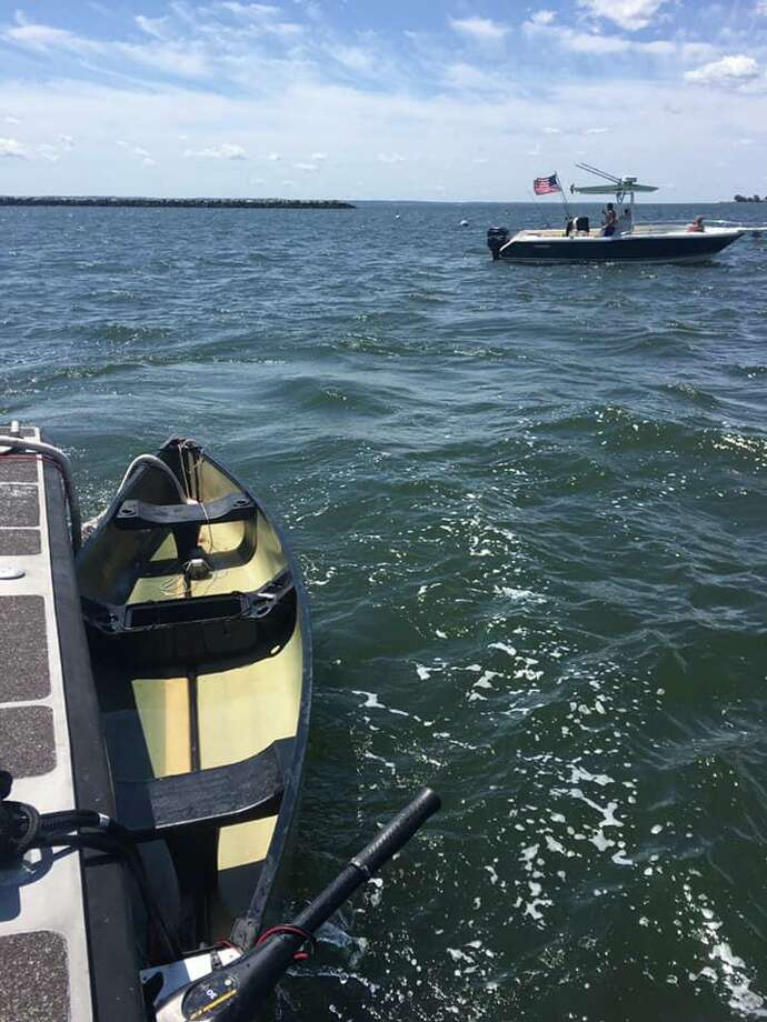 The U.S. Coast Guard Sector Long Island Sound is looking for the owner of a 10-foot canoe that was found capsized and anchored in the waters off Stamford on Saturday. Photo: Contributed Photo / U.S. Coast Guard Sector Long Island Sound