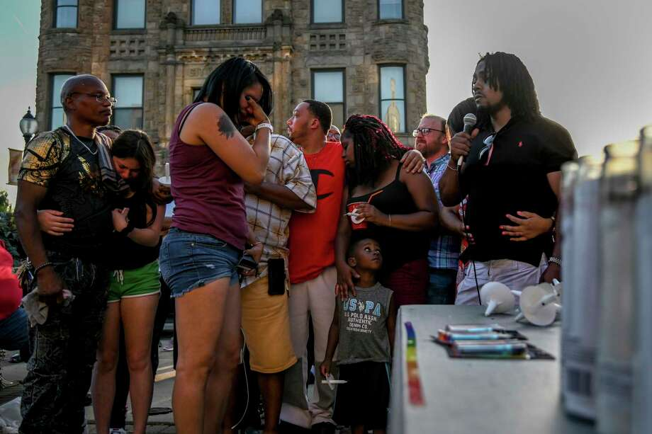 Family members of Derrick Fudge, including his brothers Roderick Fudge, far left, and son Dion Green, far right, gather for a vigil on Monday in Springfield, Ohio, a day after nine people were killed in a mass shooting in Dayton. Photo: Washington Post Photo By Jahi Chikwendiu / The Washington Post
