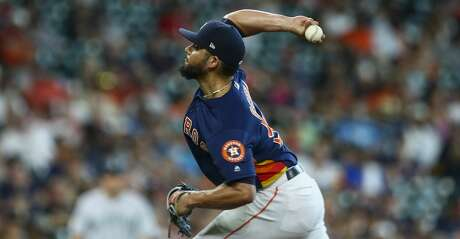 Houston Astros relief pitcher Roberto Osuna (54) throws the ball against the Seattle Mariners during the 9th inning of an MLB game at Minute Maid Park Sunday, Aug. 4, 2019, in Houston. The Astros won 3-1.