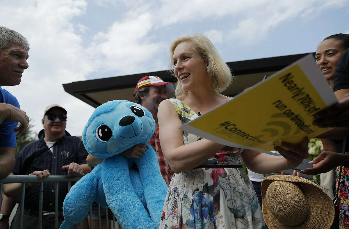 Democratic presidential candidate Sen. Kirsten Gillibrand, D-N.Y., meets with people at the Iowa State Fair, Saturday, Aug. 10, 2019, in Des Moines, Iowa. (AP Photo/John Locher)