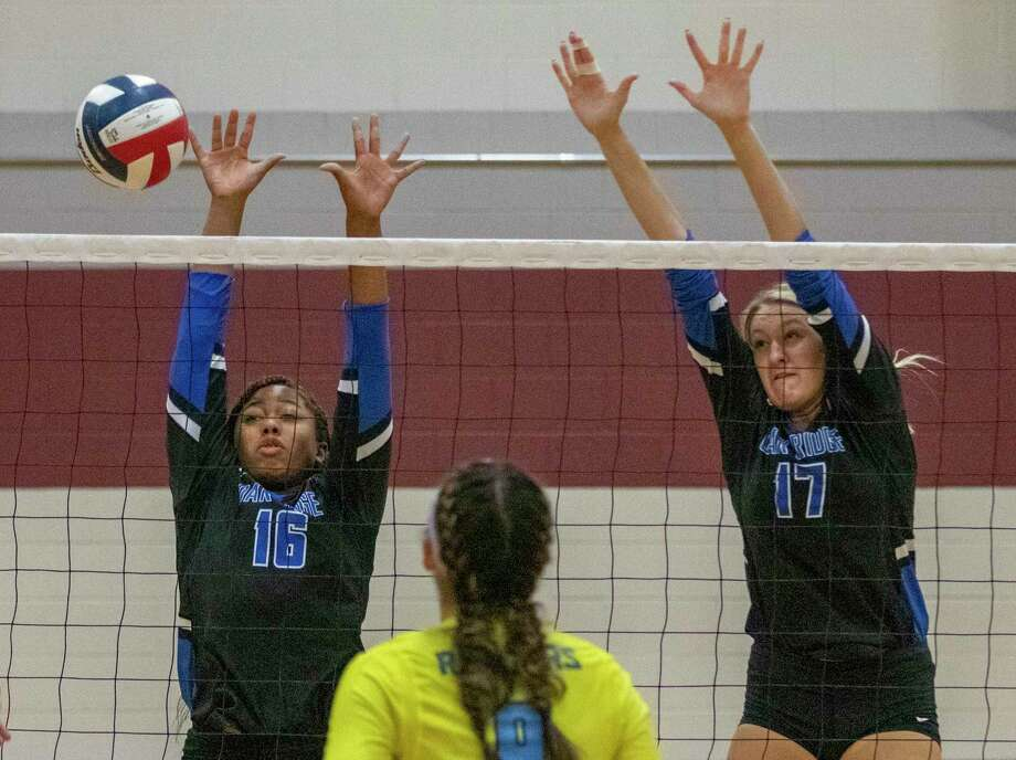 Oak Ridge junior Madison Hall (16) and senior Emma Smith (17) jump to block a kill during the Katy/Cy-Fair Volleyball Classic on Thursday, August 8, 2019 at Cinco Ranch High School. Photo: Cody Bahn, Houston Chronicle / Staff Photographer / © 2019 Houston Chronicle