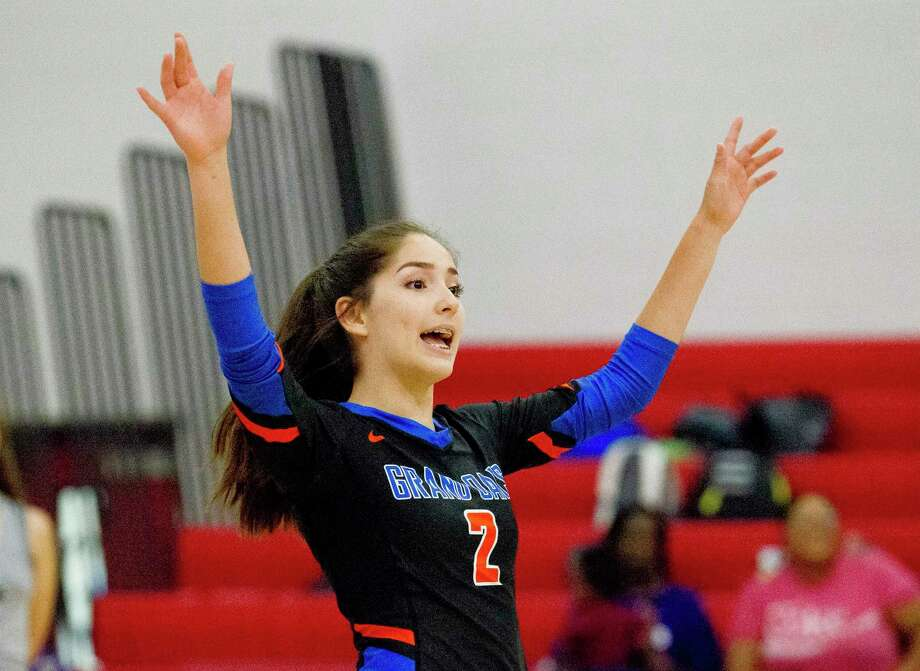Grand Oaks defensive specialist Sam Noriega (2) reacts after a point in the first set of a match during the Huffman Varsity Volleyball Tournament on Saturday. Photo: Jason Fochtman, Houston Chronicle / Staff Photographer / Houston Chronicle