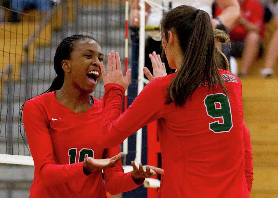 The Woodlands' Amanda Ifeanyi (10) gets a high-five from Dylan Maberry (9) after scoring a point during the second set of a non-district match at The Woodlands High School on Tuesday, Aug. 14, 2018, in The Woodlands. Photo: Jason Fochtman, Staff Photographer / Staff Photographer / © 2018 Houston Chronicle
