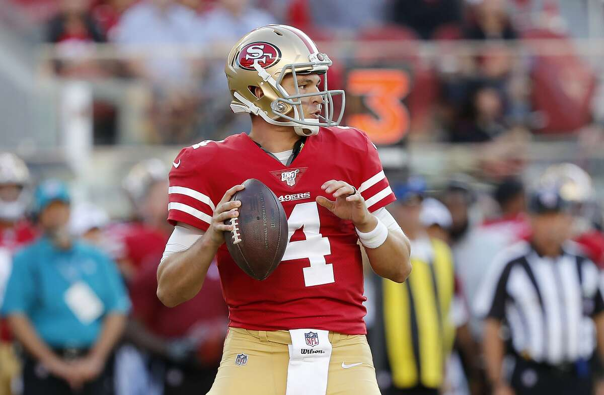 San Francisco 49ers quarterback Nick Mullens (4) looks for a receiver during the first half of the team's NFL preseason football game against the Dallas Cowboys in Santa Clara, Calif., Saturday, Aug. 10, 2019. (AP Photo/Josie Lepe)