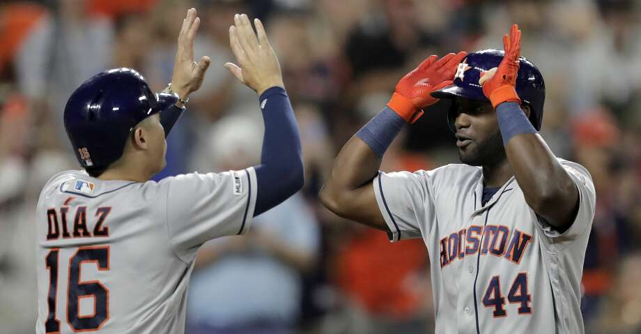 Houston Astros' Yordan Alvarez (44) is greeted at home by Aledmys Diaz (16) after Alvarez hit a grand slam off Baltimore Orioles relief pitcher Tayler Scott during the seventh inning of a baseball game, Saturday, Aug. 10, 2019, in Baltimore. (AP Photo/Julio Cortez) Photo: Julio Cortez/Associated Press