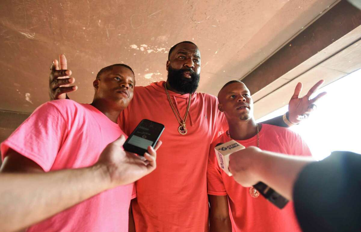 Jeffery Citizen, left to right, Kendrick Perkins and Jerrial Citizen speak to members of the media during Perkins' giveaway of 1,000 backpacks loaded with school supplies at Roberts Park Saturday afternoon. Photo taken on Saturday, 08/10/19. Ryan Welch/The Enterprise