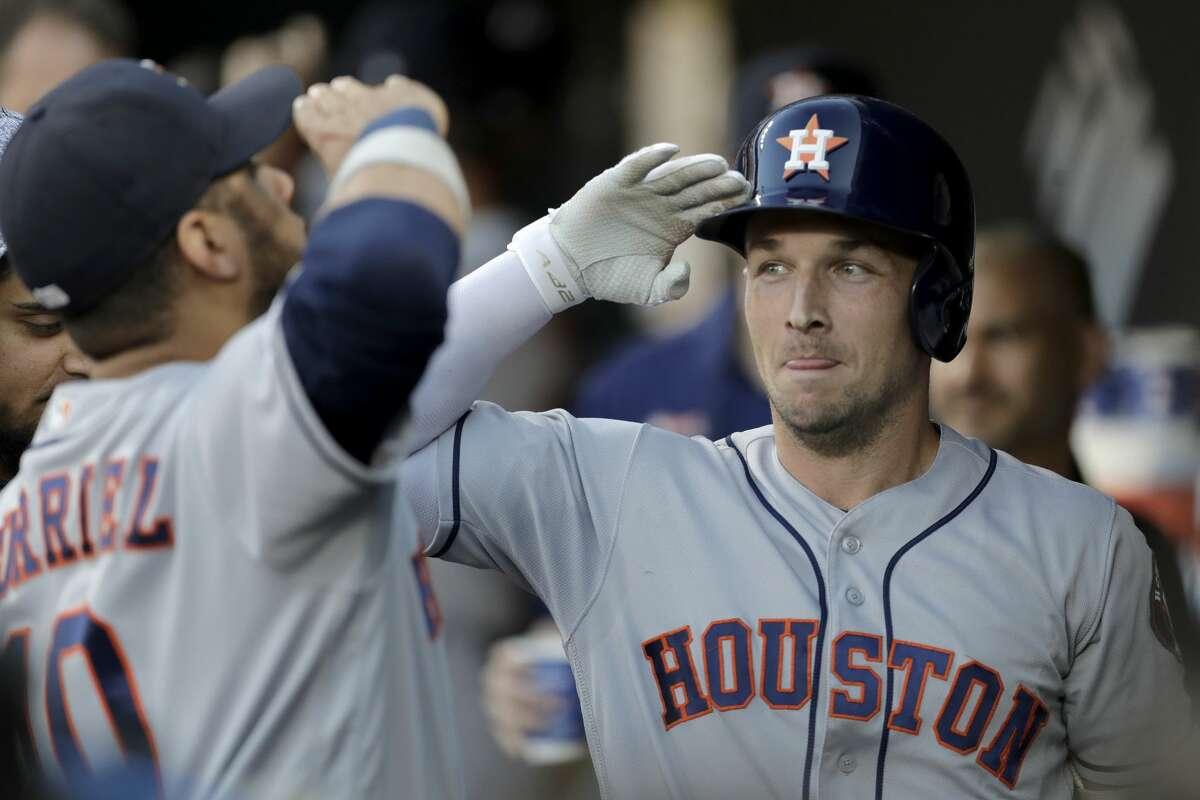 Houston Astros' Alex Bregman, right, is greeted in the dugout by Yuli Gurriel, left, after hitting a two-run home run off Baltimore Orioles starting pitcher Aaron Brooks during the first inning of a baseball game Saturday, Aug. 10, 2019, in Baltimore. (AP Photo/Julio Cortez)