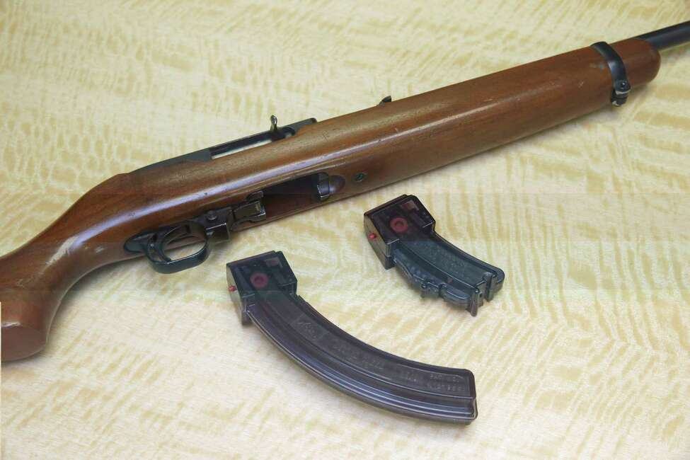 FILE - In this June 27, 2017 file photo, a semi-automatic rifle is displayed with a 25 shot magazine, left, and a 10 shot magazine, right, at a gun store in Elk Grove, Calif. California outlawed buying high-capacity ammunition magazines nearly two decades ago as one of its numerous responses to deadly mass shootings that continue to terrorize the nation, and the statea€™s progressive voters and lawmakers voted in 2016 to bar even possession of magazines holding more than 10 bullets by those who already owned them. But in 2019, a federal judge tossed out the ban, triggering a week-long buying spree before he put his decision on hold pending appeal. (AP Photo/Rich Pedroncelli, File)