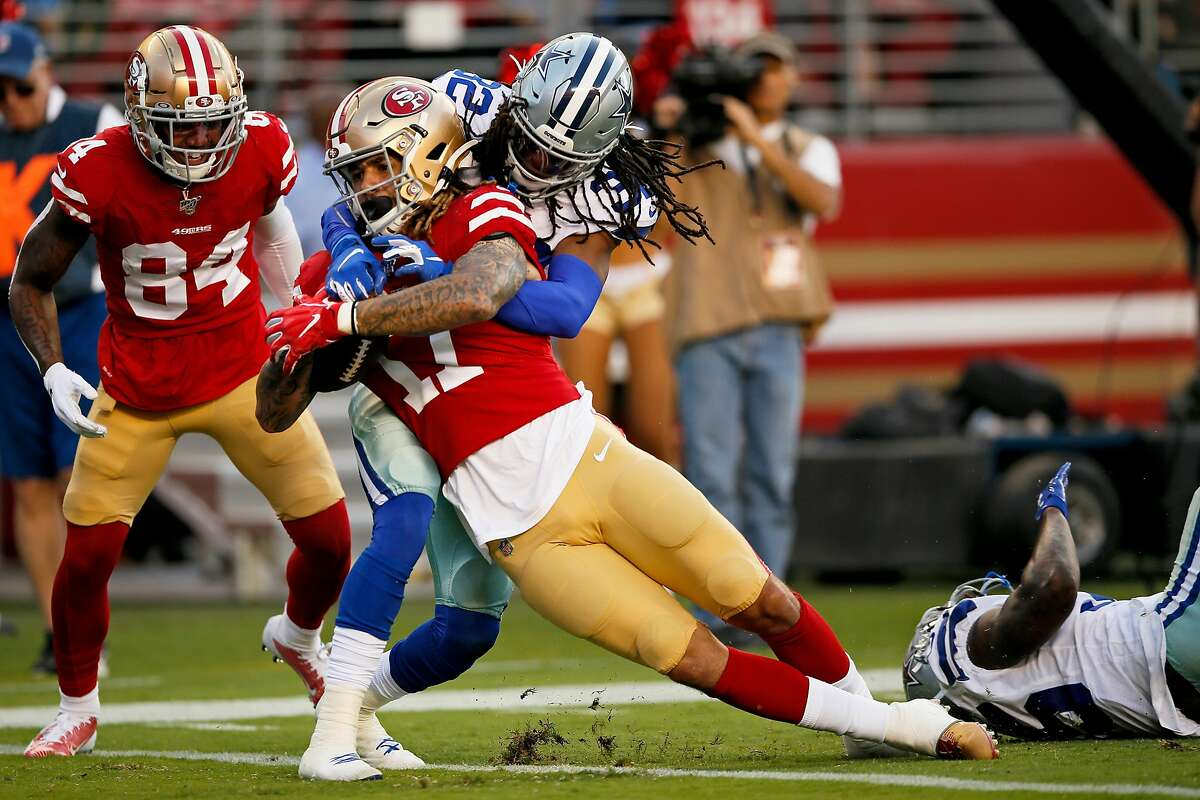 San Francisco 49ers wide receiver Jalen Hurd (17) scores a touchdown while defended by Dallas Cowboys cornerback Donovan Olumba (32) during the second quarter of an NFL preseason game against the Dallas Cowboys at Levi's Stadium on Saturday, Aug. 10, 2019, in Santa Clara, Calif.