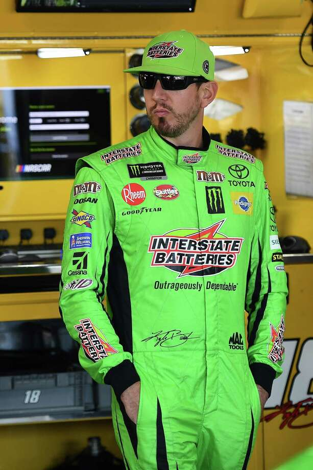 BROOKLYN, MICHIGAN - AUGUST 10: Kyle Busch, driver of the #18 Interstate Batteries Toyota, stands by his car during practice for the Monster Energy NASCAR Cup Series Consumers Energy 400 at Michigan International Speedway on August 10, 2019 in Brooklyn, Michigan. (Photo by Stacy Revere/Getty Images) Photo: Stacy Revere / 2019 Getty Images